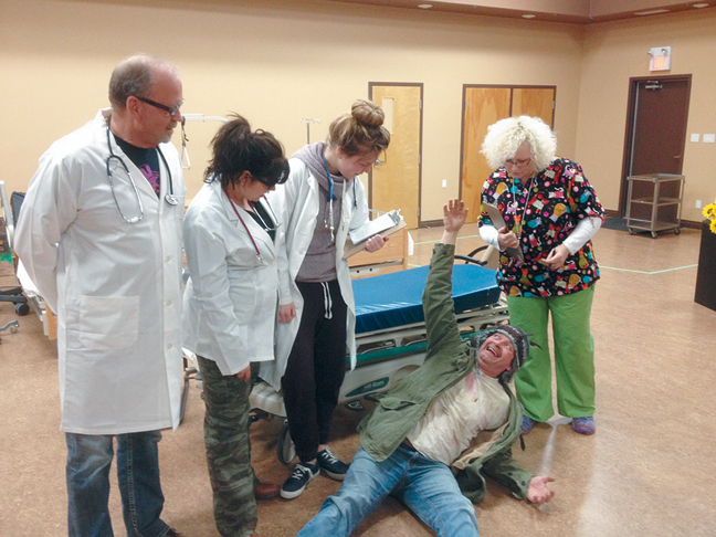 BEDSIDE MANNER: Dr. Jekyll (Dirk Geerligs), interns Sweets (Sarah Kropf) and Pinch (Afke Muller), and nurse Miss de Farge (Alana Johnson) deal with the woes of a 'crawl-in' patient (Hans Wesseling) during a rehearsal of 'Hospital,' a two-act comedy being performed at St. Joseph's Church Hall in Vauxhall beginning March 12. The play runs March 12-14 and March 19-21 with 7 p.m. performances, with a 1 p.m. matinee showing on March 21 as well. Tickets are available at Hometown Hardware and Gifts.