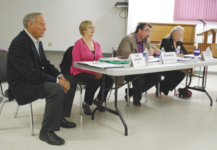 Little Bow candidates respond to questions from the floor during the Vauxhall Election Forum on April 30 at the Vauxhall Legion Hall. The evening was moderated by former MLA Ray Speaker (foreground).